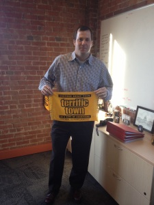 Matt Crocco, an ardent Pittsburgh Steelers  supporter , poses with a Terrible Towel in  Bravo's Pittsburgh office.